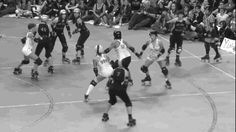 Protect Yourself—Even in the Non-Derby Direction RH side of the screen. Check out the way the white-jersey skater whips around at the last minute and gives the black-jersey skater her back, forcing the Back Block call. Pretty sneaky, sis.