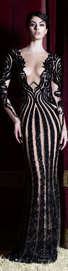 Zuhair Murad.Pre-Fall 2015.  These stripes are fantastic.  I love the idea of a 2-color dress.  Straight lines drawing the eyes downward.  Curly or knotted lines on the arms.  A big V on the front of the bodice to make the waist appear narrower.  So many cool things about this design.  No skin required.