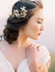 low messy wedding updo hairstyle with hairpiece