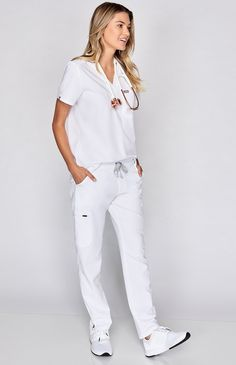 Why We Love This Polish your professional look with our most stylin' scrub pant yet. A tapered, skinny fit offers a contoured silhouette, equipped with our sign Scrubs Outfit, Scrubs Uniform, White Scrubs, Beautiful Nurse, Medical Scrubs, Nurse Scrubs, Female Doctor, Nursing Clothes, Scrub Pants