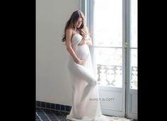 Adorable photo to take while pregnant. :)