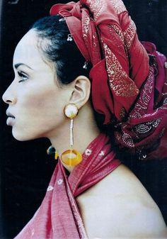 Cultural. Head wrap, simple make up, large earrings