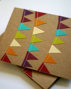 how beautiful are these cards. and with colored paper and a sewing machine totally do-able!
