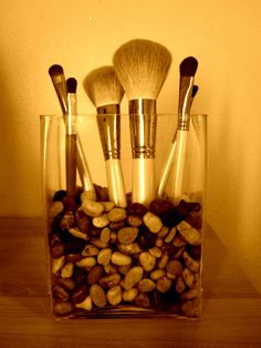 Found a better place to put my makeup brushes. Just add rocks (same sized rocks work best) into a glass vase and Voilà!