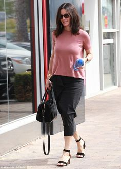 Pretty in pink! The former Cougar Town star looked lovely in a rosy-couloured blouse and flowing skirt