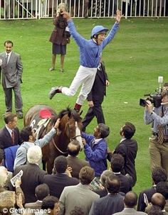 Frankie Dettori celebrating during a meet in which he won every race at Ascot in September 1996. Getty Images