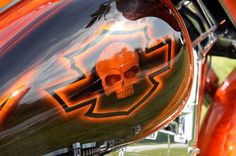 Harley Davidson Shield, bar, and skull. orange and black Love it
