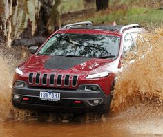 Four Wheeler of the Year award for 2015 Jeep Cherokee Trailhawk. 2015 Jeep Cherokee Trailhawk gets SUV award - the judges impressed by the new Jeep's genui