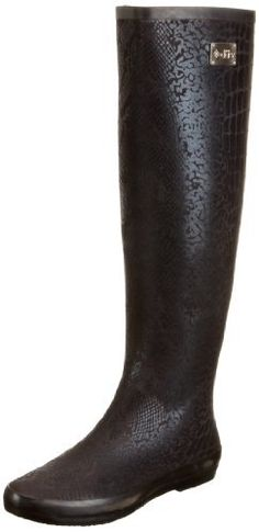 "dav Women's Festival Snake Rain Boot,Black,6 M US dav. $65.00. Manmade sole. Shaft measures approximately 16.75"" from arch. Heel measures approximately 0.5"". Boot opening measures approximately 15.75"" around. Fabric and synthetic. Made in China"