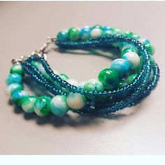 Check out this item in my Etsy shop https://www.etsy.com/listing/473173714/blue-green-beaded-bracelet-blue-and