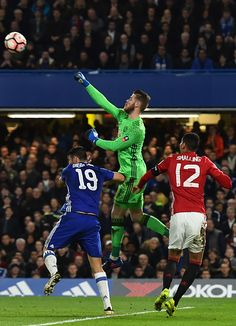 Manchester United's Spanish goalkeeper David de Gea is hurt in this clash with Chelsea's Brazilianborn Spanish striker Diego Costa as he comes to...