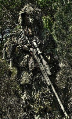 Ghillie suit sniper. Perfect camouflage for the long distance shot.