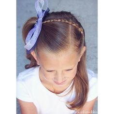 Little girl hairstyle - Half up style ... braid pulled over to a high side pony :).