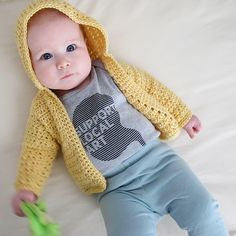 Cute crocheted baby hooded cardigan.