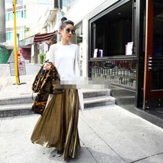 Pleated gold maxi skirts. Looked forever and only found this. http://www.aliexpress.com/item/Shiny-textile-fabrics-Khaki-organ-plait-pleated-color-ding-Noble-dress-fabric-bag-bag/1919955939.html