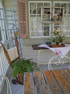 I have an old feed store dolly like the one pictured here. I like how they have it styled on this vintage front porch.