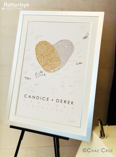 Wedding Guest Book Idea Created with your fingerprints by Flutterbye Prints. Love the gold and silver wedding theme! Photo by Chaz Cruz