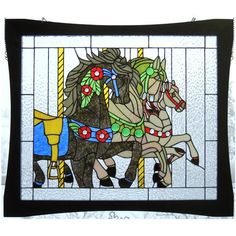 """Carousel - Artist Diane McKee; Pattern adapted from PDQ Stained Glass Patterns; Foiled panel is 29.5"""" x 24.5""""."""