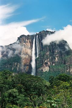 Angel Falls in Venezuela is the world's highest waterfall at 3,212 feet tall. The water that comes over the top of the mountain falls for 2,647 feet before plunging into the Kerep River below. Oh The Places You'll Go, Places Around The World, Beautiful Places In The World, Places To Visit, Places Ive Been, Amazing Places, South America, Latin America, Poker Chips