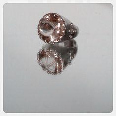 A gorgeous rutilated buff top quartz I'm a castle setting.  Www.shopanacavalheiro.com