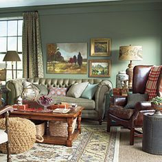 Decorate with Green   Created with the feel of a warm and cozy den, this entertainment room contains rich upholstery and textiles and dark-stained furniture, which pair well with the mint green shade.   SouthernLiving.com