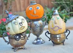 Pumpkins with attitude created with bits and pieces of old jewelry, typewriter keys, buttons, flower frog, and silver cups. From MySalvagedTreasures.com