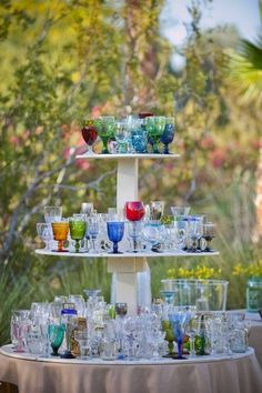 Glasses - Mixing shades and shapes is fun and also helps your guests to know which one is theirs! Double the fun and give as wedding favors. Eclectic Wedding Decor: Mix and Match Style on intimateweddings.com #wedding #favors