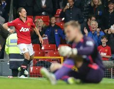 Chicharito celebrates goal against Liverpool in Capital One Cup.