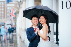 engagement pre wedding photographer London Kensington Natural history museum rainy day couple  (34)