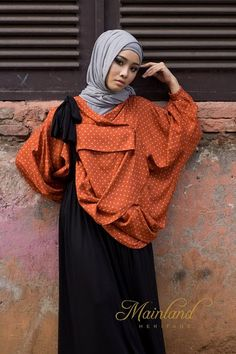 I'm not sure how I feel about this modest clothing look... definitely trendy, but dissheveled somehow... Still, I give the hijab / modest dress a thumbs up!