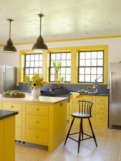 10 Colorful Kitchens ~ easily change the look and style of your kitchen by painting the cabinets. How about sunny yellow?