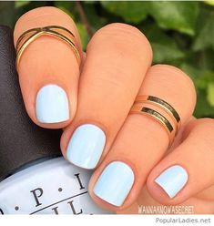 Awesome OPI nail polish color on light blue