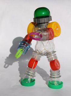 Bottle robot- toys from trash – – Handwerk und Basteln Reuse Plastic Bottles, Plastic Bottle Crafts, Recycled Robot, Recycled Crafts, Diy Toys Recycled Materials, Toys From Trash, Diy Robot, Cardboard Crafts, Handmade Toys
