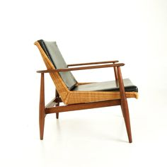 Walnut, Wicker and Leather Chair | From a unique collection of antique and modern armchairs at https://www.1stdibs.com/furniture/seating/armchairs/