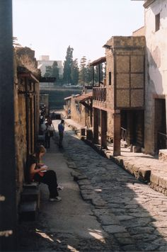 An excavated street of ancient Ercolano, Italy (Herculaneum) that was once covered by hot mud from an erruption of Mt. Vesuvias.
