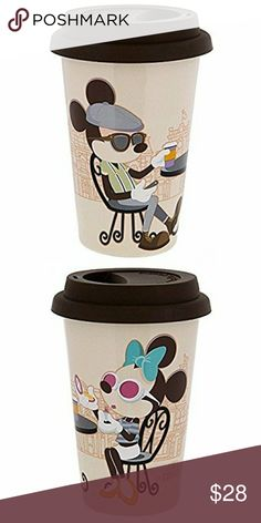 Mickey & Minnie Travel Mug with Lid Brand New! Disney Mickey Mouse and Minnie Mouse Ceramic Insulated Travel Mug with Lid  -brand new, no tag as it didn't come with a tag  -Bought in Disneyland -Pour in some of ''Mickey's 'Really Swell' Coffee Brand'' into this inviting travel mug featuring Mickey and Minnie, who will wake up your day each morning thanks to this mug that's perfect for hot beverages on the go. -Detachable silicone lid/Holds approx 10 oz -3 3/4'' D x 5 1/2'' H -Mickey on one…