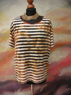 Post apocalyptic striped shirt, rusty blouse, wasteland blouse, wasteland costume, upcycled clothing, reworked top, art to wear, Mad Max,  Wild wasteland striped top. Hand bleached and rusty blouse . so it has an amazing look. Colors: black, white and rusty:) OOAK top best for wasteland costume and post apocalyptic style or others...  the best for size S-L  bust approx 120cm/ 47 length 57 cm/ 22 top is elastic  Please any questions or concerns before the purchase. Thanks for looking...