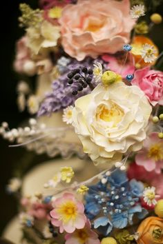 A breathtakingly beautiful wildflower wedding cake with sugarpaste flowers | The Natural Wedding Company