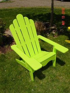 lime Adirondack chair....on the drive to my sisters in Wexford,Pa. A homeowner has 5 hot pink adirondack chairs. Looks great on the green grass.