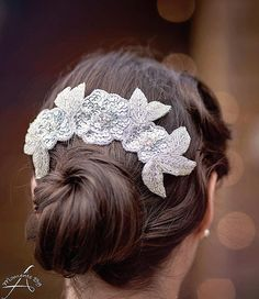 This nylon comb ($78) features three sparkly sequin-and-rhinestone flowers with silver beaded leaves. Wear it over a hair bun to give your entire look more oomph. // Affordable Bridal Hair Accessories