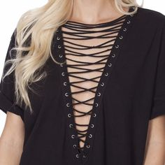 ✨HP✨NWT Oversized Boyfriend Lace Up Tee Super cute oversized lace up boyfriend tee carried by LF. NWT and only worn to try on. Can be worn as a dress or shirt! I'm hesitant on selling this (b/c it's so cute) but if I do, I want the amount I paid for it. Firm on price, lower offsite. No trades please. LF Tops