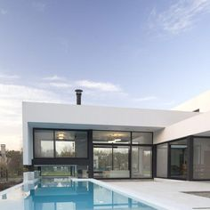 Black&White Latest Family House With Impressive Swimming Pool , From afar, this modern residence developed by the creative team at Andres Remy Arquitectos looks like a black and white monolith, pierced by glazing from place to place. The Grand Bell House project is located 50km away from Buenos Aires, Argentina, but i , Admin ,...