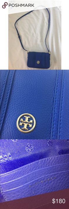 Tory Burch Cross body Blue Tory Burch cross body in excellent condition! No peeling in leather, chipping in hardware or staining in the bag interior. This bag is so cute and fits all the essentials like a small wallet a lipstick and sunglasses. Only used a few times, comes with the original tag as well! Tory Burch Bags Crossbody Bags