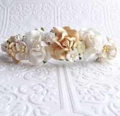 Find this piece here: https://www.etsy.com/listing/222429072/the-ivory-and-white-floral-crown