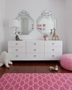 Modern, clean, chic big girl room with pink accents