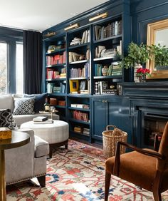 Dark blue bookcase family room traditional with sectional high gloss library sconce