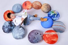 A solar system pillow set, perfect for lounging -- and learning! $349 per set.