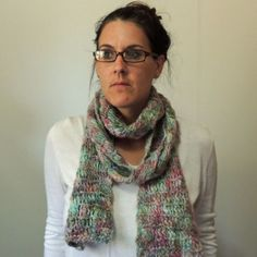"NWOT - Multicolor Wool Knit Scarf Hand knit scarf by me with 100% wool in a lovely multicolor (pinks, blues, greens) yarn. One of a kind scarf! Dry clean recommended or gently hand was with mild soap in cold water, lay flat to dry. It's 100% wool so can not go in dryer or hot water!!! Measures - 85"" long x 5"" wide. One size fits most  Please don't hesitate to ask questions, thanks! Lewis Knits Accessories Scarves & Wraps"