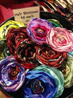 Hair flowers in every color, only $6 each. By Brandi Crye, Crye's Creations in #151 on Yew. See http://www.holidaymarket.org for shopping info