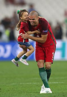 #EURO2016 Pepe of Portugal celebrates his team's win wit his daughter after the UEFA EURO 2016 quarter final match between Poland and Portugal at Stade...
